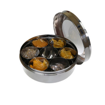 masala dabba, stainless steel spice tin open with lid, contains 7 pots filled with different spices