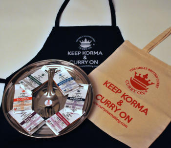 apron with cotton shopper a round tray with 6 curry kits a rice spoon