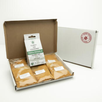 5 sachets 1 Tikka Masala Kit displayed in a letter postal box open with a closed box with a handpacked with love sticker