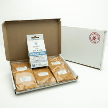 5 sachets 1 Biryani Rice Kit displayed in a letter postal box open with a closed box with a handpacked with love sticker