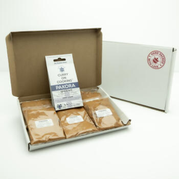 5 sachets 1 Pakora Curry Kit displayed in a letter postal box open with a closed box with a handpacked with love sticker