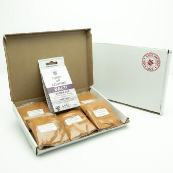 5 sachets 1 Balti Curry Kit displayed in a letter postal box open with a closed box with a handpacked with love sticker