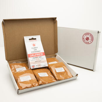 5 sachets 1 Jalfrezin Curry Kit displayed in a letter postal box open with a closed box with a handpacked with love sticker