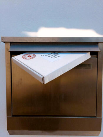 Mailbox with package protruding
