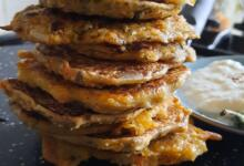 a stack of mini oat panckaes on top of a chapatti makeing pan a tawa